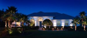 Good landscape lighting will highlight the home and landscaping